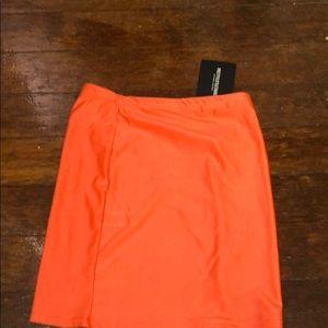 Orange disco mini skirt